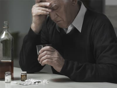 sad elderly man portraying alcohol and drug abuse