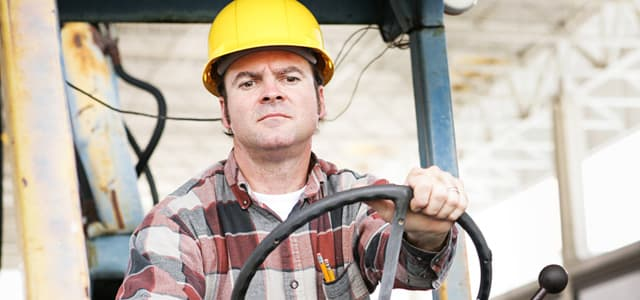 man driving bulldozer portraying a blue collar construction worker with addiction problem