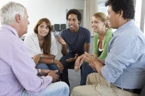Group of people talking in an alcohol recovery center