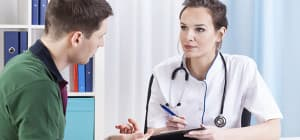 Man talking to doctor in an outpatient rehab center