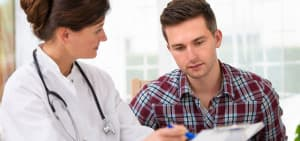 recovery-shutter111443774-female-doctor-with-clipboard-male-patient