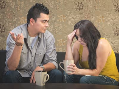 Husband talking to spouse about alcoholism