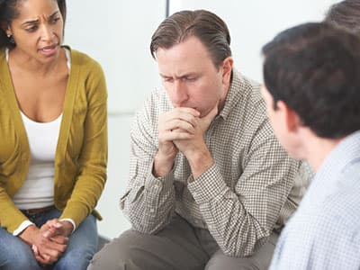 Man discussing relapse at a 12-step meeting