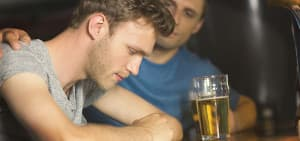 recovery-shutter244004512-man-comforting-friend-at-bar