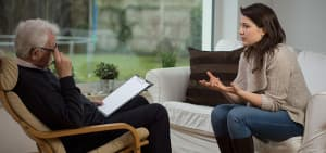 recovery-shutter247411348-therapist-speaking-to-woman