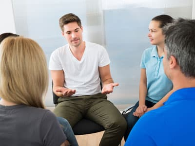 Man attending outpatient addiction therapy