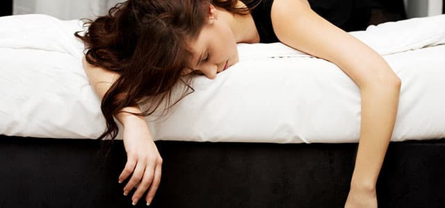 recovery-shutter272861114-woman-passed-out-on-bed