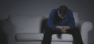 recovery-shutter275147645-depressed-man-sitting-alone-on-couch