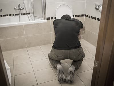 Man who is addicted to Flexeril vomiting
