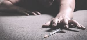recovery-shutter297079967-woman-grabbing-syring-of-heroin