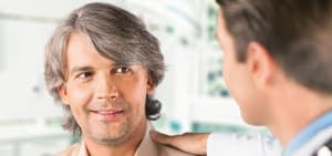 recovery-shutter302077865-man-comforted-by-doctor-hand-on-shoulder