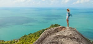 Woman on cliffside enjoying the view