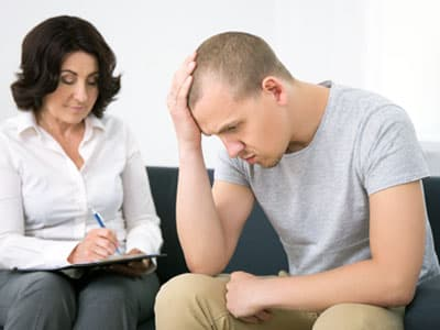 Man seeing therapist for antidepressant recovery