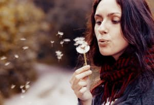 recovery-shutter48624034-woman-holding-dandelion