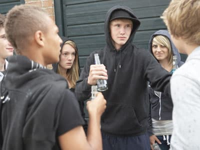 Group of underage teenagers drinking