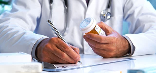 recovery-shutter95385217-doctors-hands-writing-prescription