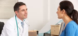 recovery-shutter98521109-male-doctor-consulting-female-patient-in-office