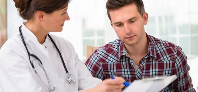 man talking to doctor in a steroid addiction recovery center
