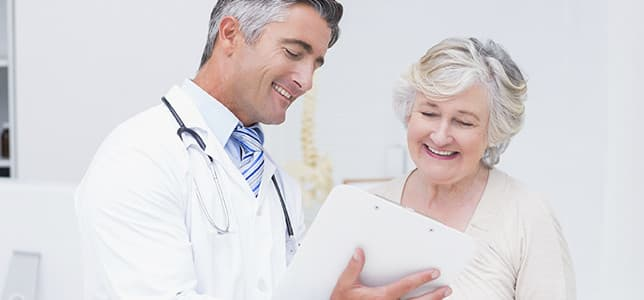 Woman talking to doctor about recovery
