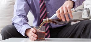 recovery_shutterstock-167097482-man-alcohol-addiction-pouring